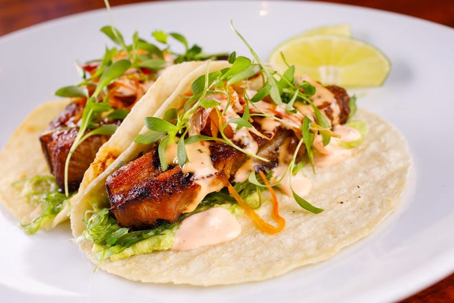 One of the new items on the seasonal menu at Timeless in Naples includes pork belly tacos with miso-hoisin glaze, wasabi avocado puree, kimchee pickled vegetables and sriracha aioli.