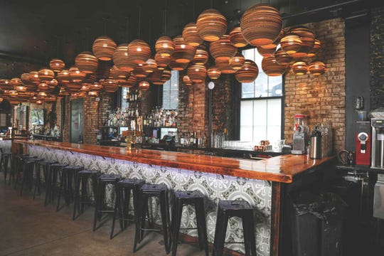The bar area lights at Talde in Jersey City are made from cardboard.