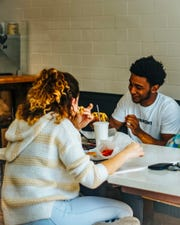 Two customers share a meal at BurgerHaus.