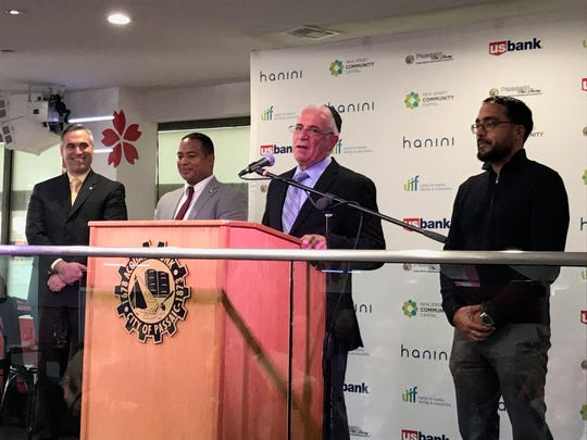 City Council President Gary Schaer, Mayor Hector Lora, Business Administrator Rick Fernandez and Councilman Salim Patel at the ribbon cutting for the 663 Main Street in Passaic.