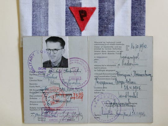 "A piece of a concentration camp prisoner uniform belonging to Zdzislaw Kozlowski, known in America as Brother Stanley. Also pictured is a document that verifies his imprisonment in a Nazi concentration camp. Kozlowski was one of the Polish Capuchin Franciscan Friars who survived brutal treatment in Nazi concentration camps in Poland and Germany during World War II. The letter ""P"" is for ""political prisoner."""