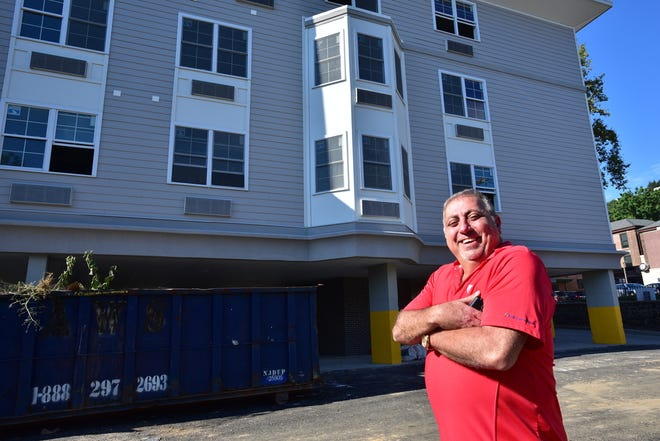 Fred Daibes, a local developer in Edgewater, poses for a photo by a affordable housing building on Winterburn place in Edgewater in 2016.