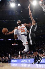 New York Knicks' Mitchell Robinson (26) drives past Brooklyn Nets' Jarrett Allen (31) during the first half of an NBA basketball game Monday, Oct. 29, 2018, in New York.