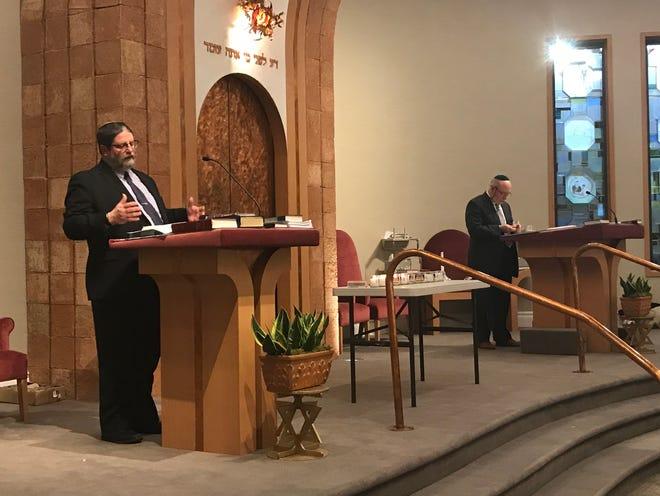 Rabbi Randall C. Mark, at left, speaks to the crowd at Shomrei Torah in Wayne Oct. 29, 2018.