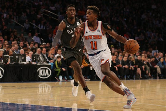 New York Knicks guard Frank Ntilikina (11) drives against Brooklyn Nets guard Caris LeVert (22) during the first quarter at Madison Square Garden.