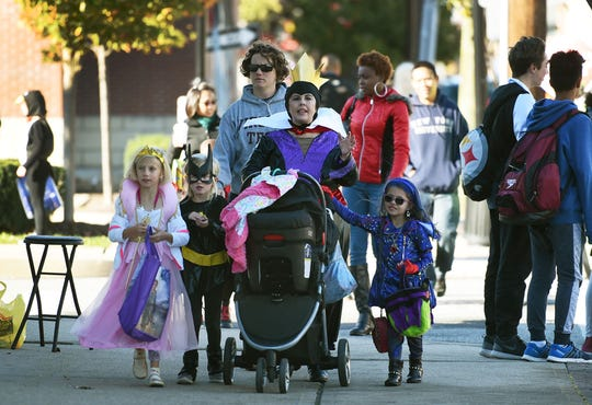 Jamie Blanchard of Fair Lawn walks with her daughter Gia (age 6, right) and Gia's classmates as they go door to door for trick-or-treating along River Road in Fair Lawn on 10/31/17.
