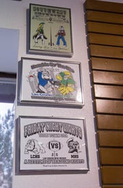 Older designs of the Cruces Mayfield Rivalry t-shirts at the Sports Accessories shop Tuesday October 30, 2018.