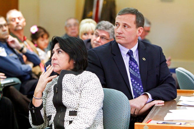 In this Feb. 8, 2014 file photo, Demesia Padilla, the former Cabinet Secretary with State Revenue and Taxation Department, left, and former Rep. Paul Pacheco, R-Albuquerque, listen to the audiences during a committee meeting at the New Mexico State Capitol in Santa Fe. Padilla on Thursday, June 28, 2018 was charged with embezzlement, and multiple corruption and ethics violations stemming from her time as Cabinet secretary. Former Taxation and Revenue Department secretary Padilla is scheduled to appear Monday, Oct. 27, 2018, in state court for a hearing on whether evidence is sufficient for a trail to go forward. (Jane Phillips/The Santa Fe New Mexican via AP, File)