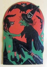 This die-cut Halloween image from the 1940s is one in a series of 14 produced by the Beistle Co. It's 18 inches tall and embossed on thick cardboard.