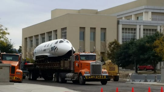 A portion of a replica of SpaceshipTwo, the Virgin Galactic ship that will take passengers to suborbital space, is seen loaded on a semi-truck on the morning of Tuesday, Oct. 30, 2018 in front of Las Cruces City Hall, 700 N. Main St., Las Cruces. The replica has been stationed in front of city hall since the spring. It will return to Spaceport America in southeastern Sierra County.