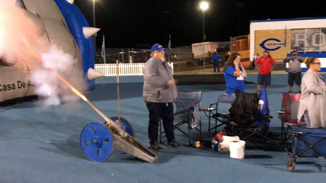 Bruce Chitwood fires off the canon after Carlsbad scored against Las Cruces on Oct. 26.