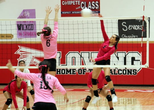 Loving's Anyssa Rodriguez (5) spikes the ball during the first set of Monday's game against Hagerman. Rodriguez finished with three kills in the match.