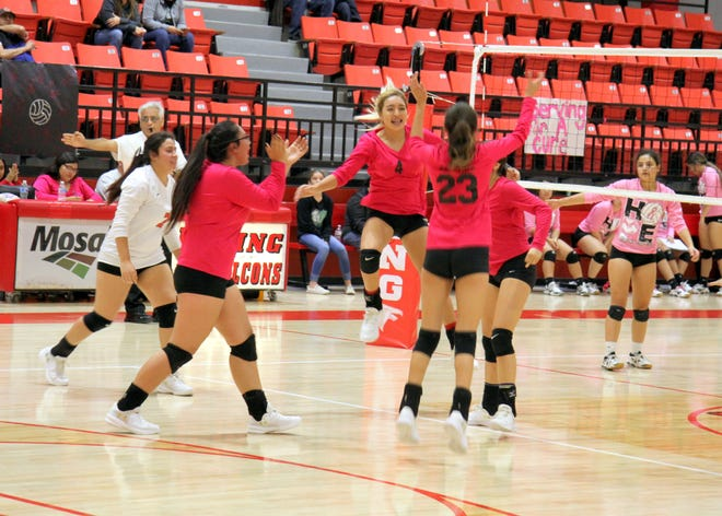 The Falcons celebrate their sweep of Hagerman on Monday's.