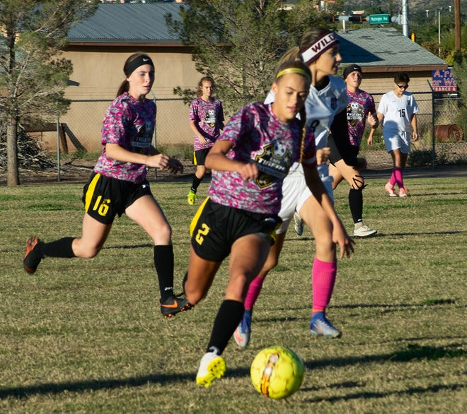 Alamogordo Lady Tiger senior Sheyenne Drake dribbles the ball past Deming Lady Wildcat Julissa Chavez to score the team's seventh goal in a 10-0 rout of the Lady Wildcats on Oct. 25.