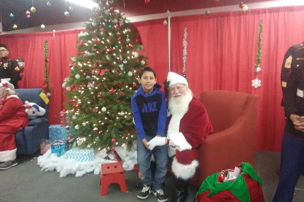 Fernando Hernandez, 9, of Bloomfield, New Mexico, poses Dec. 23, 2017, with Santa Claus during a Toys for Tots event at McGee Park in Farmington, New Mexico. Fernando died Oct. 26, 2018, when his family took him off life support after he suffered a brain hemorrhage from the effects of hantavirus.