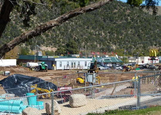 Workers are busy on the construction site of the replacement hospital.