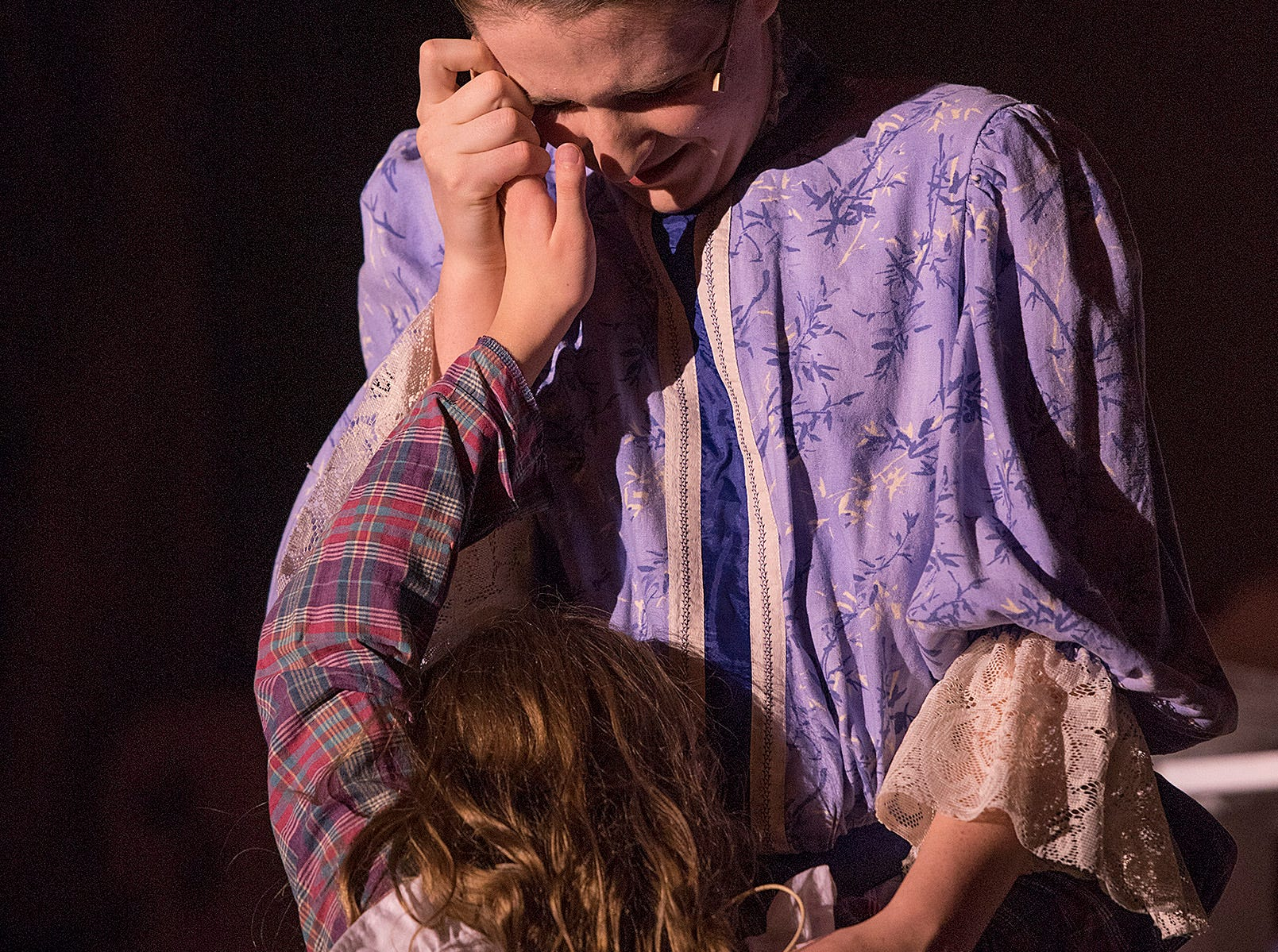 Kate Keller (Emma Pickett) breaks down upon learning that her daughter Helen (Jillian Picketti) folded her napkin after the meal, offering hope to Kate.