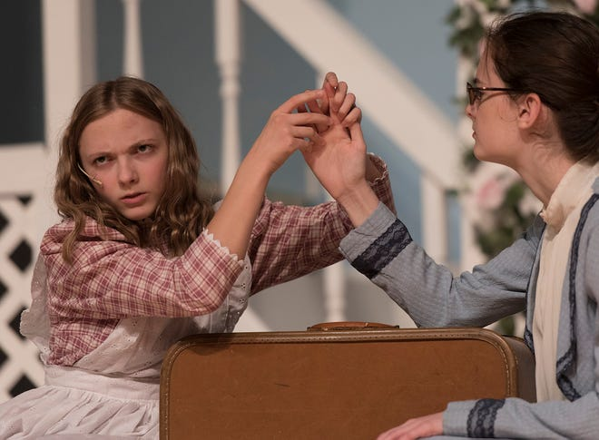 Annie Sullivan (Caitlin Griffin) teaches Helen (Jillian Bocketti) letters with her hands, but the child has no concept of what they mean.