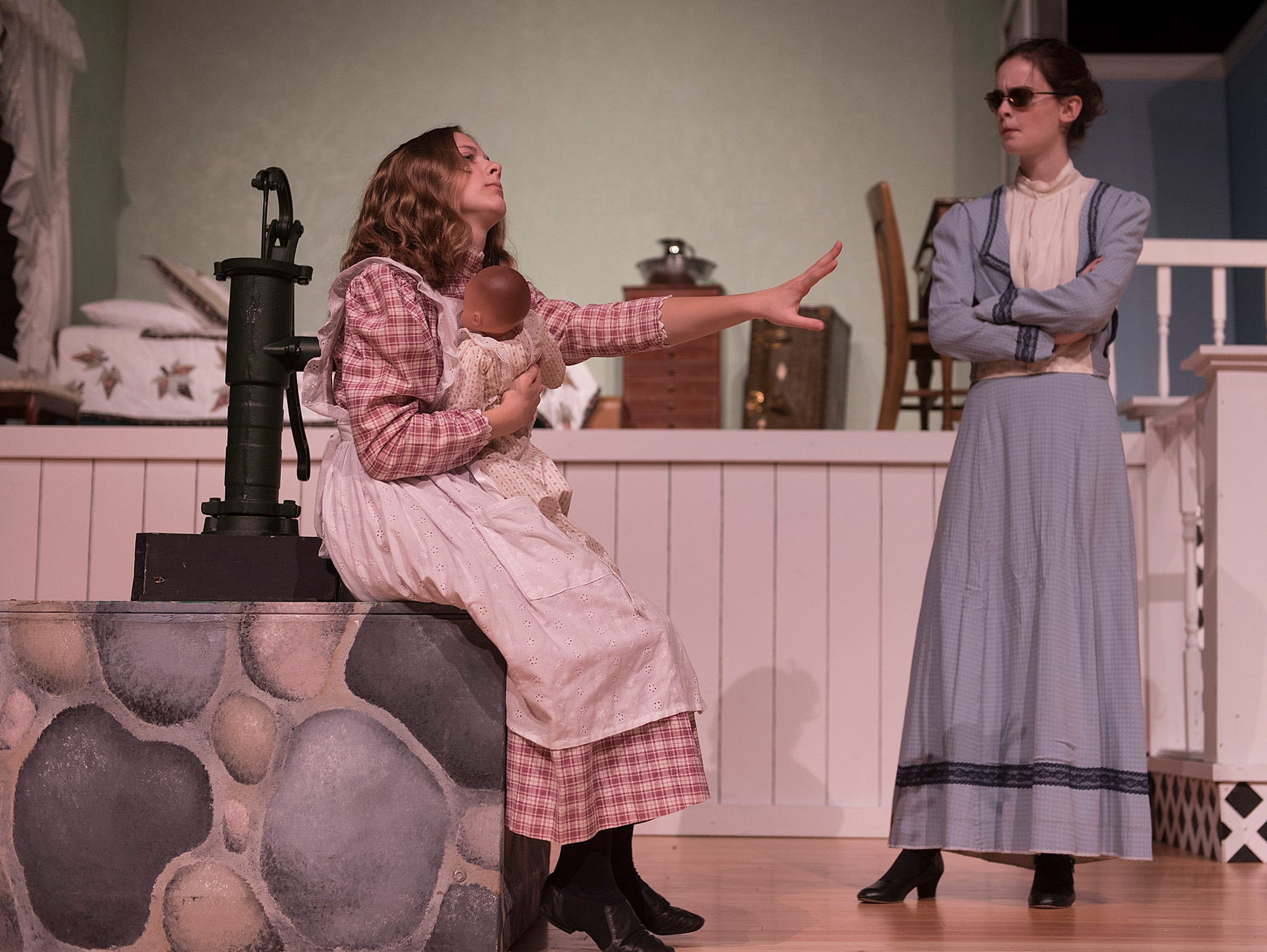 Annie Sullivan (Caitlin Griffin) gives her new charge Helen Keller (Jillian Bocketti) a doll, but it does nothing to help Helen bond with her teacher.