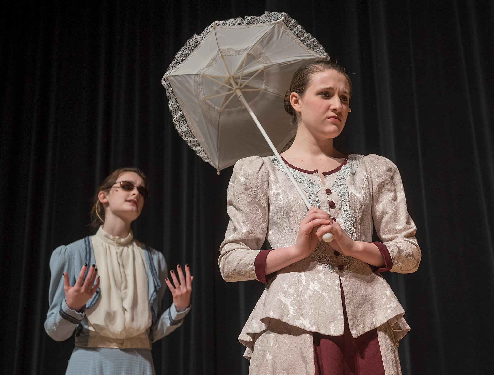 At the train station, Kate Keller (Emma Pickett) is dismayed to discover that Annie Sullivan (Caitlin Griffin) is young, and just out of school.