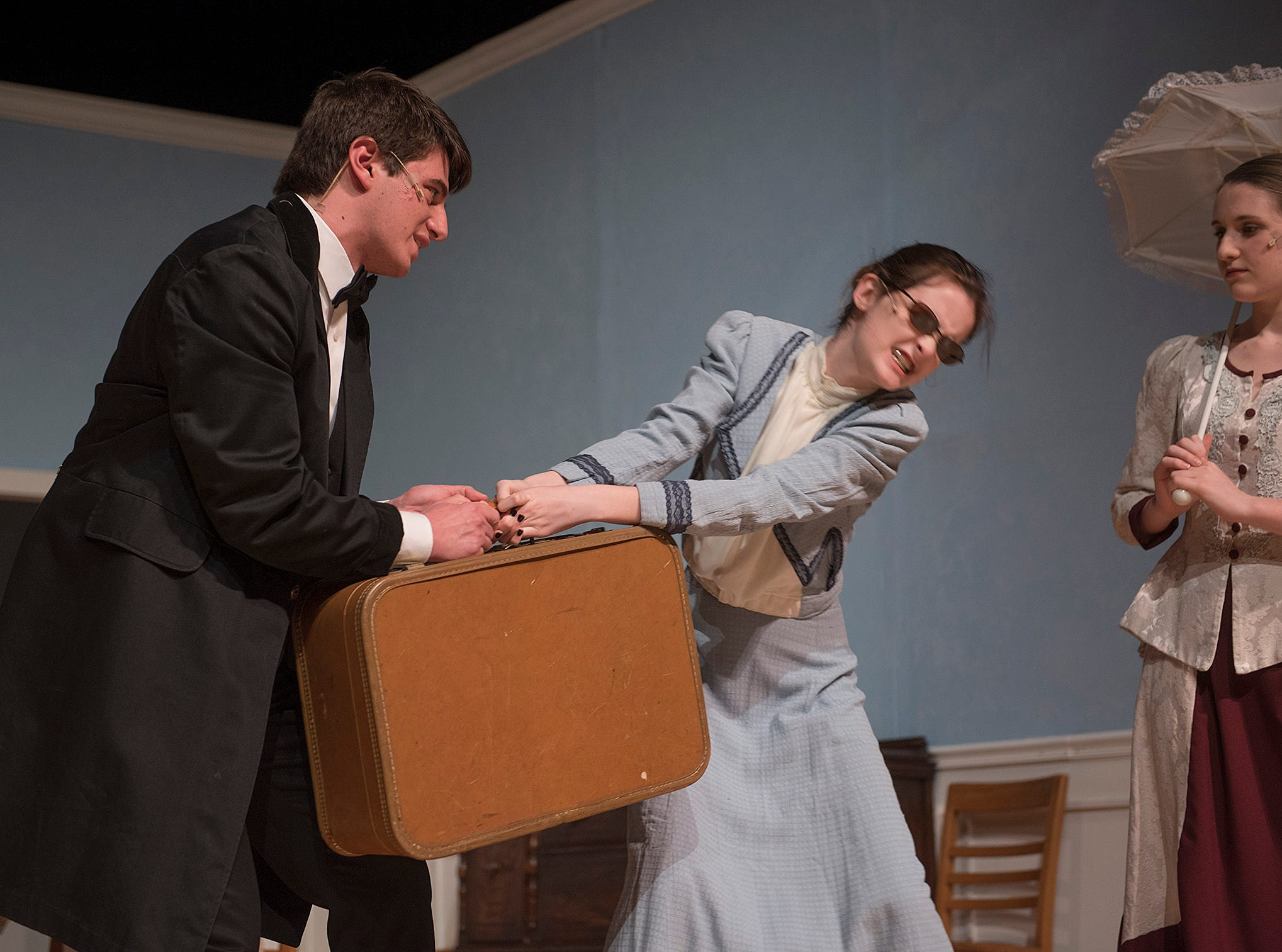 Captain Keller (Charles Hilu) , a veteran of the Confederacy, isn't used to young womwn from the northern states who don't immediately defer to him. Annie Sullivan (Caitlin Griffin) will carry her own luggage.