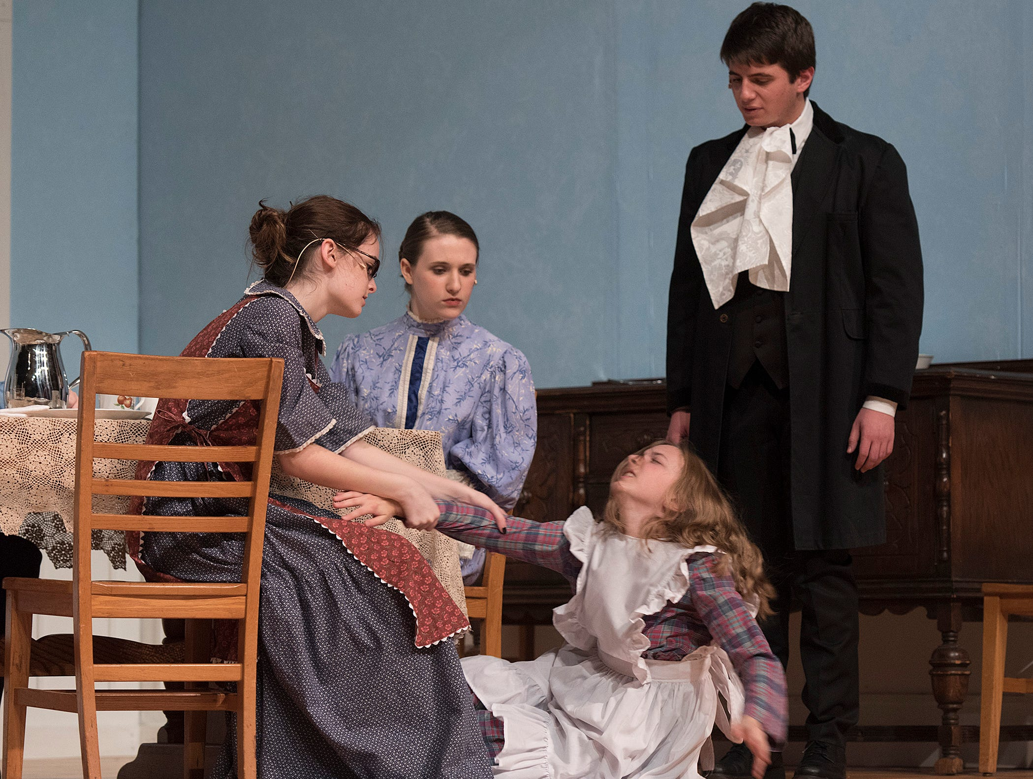Annie Sullivan wont allow Helen's tantrum to disrupt the family meal in spite of the protests of parents Kate Keller (Emma Pickett) and Captain Keller (Charles Hilu).