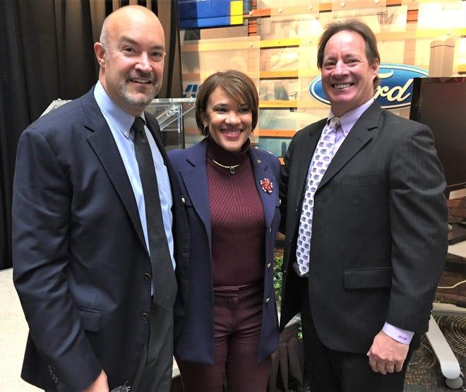 Flint Mayor Karen Weaver (middle) is all smiles with Michigan Bucks President Costa Papista (left) and Chairman Dan Duggan.