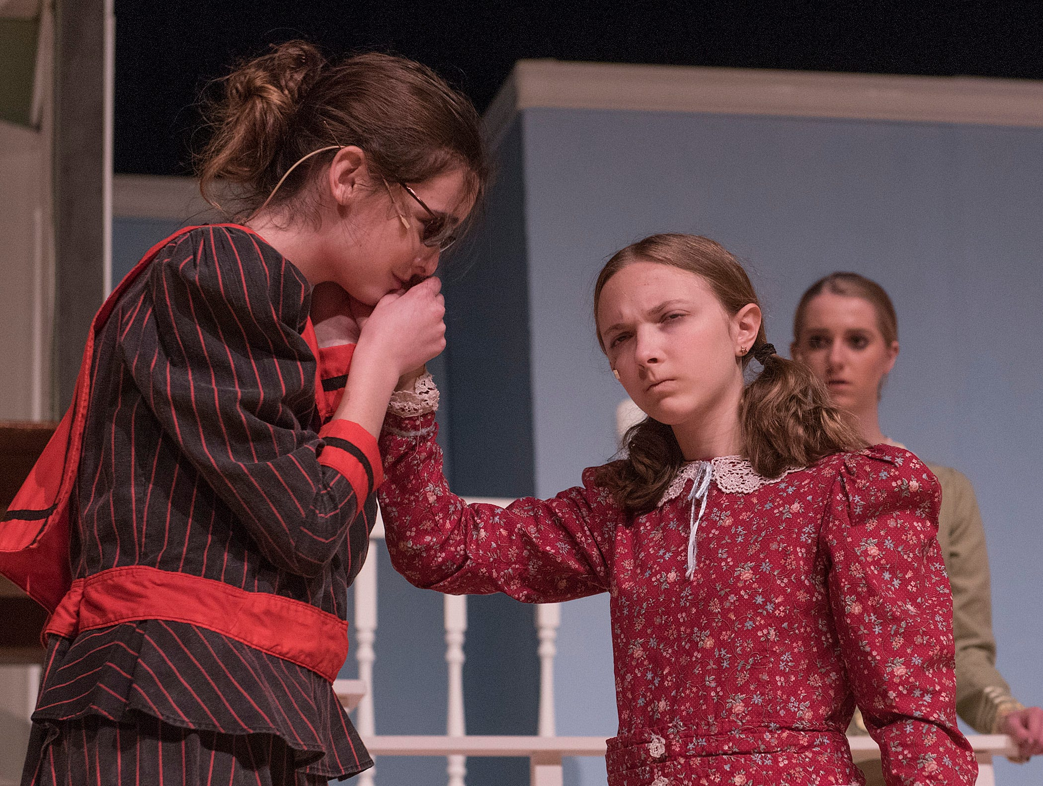 Teacher. Helen Keller (Jillian Bocketti) connects the letters and words with the woman teaching her their meaning, Annie Sullivan (Caitlin Griffin).