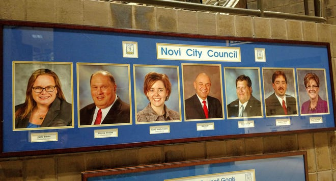 Photos of the Novi City Council members outside the council chambers at the Novi Civic Center. Thirteen people have applied to fill the seat left vacant by Councilman Wayne Wrobel's death in October.