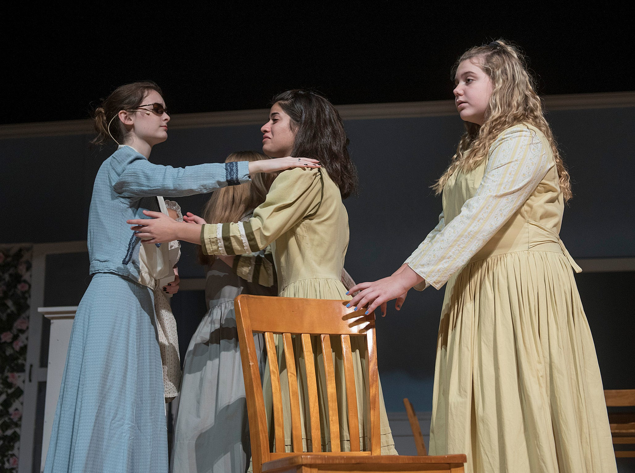 Annie Sullivan (Caitlin Griffin) says goodbye to her blind friends at the Perkins Institute for the Blind (Grace Ajo and Kamryn Swickard).