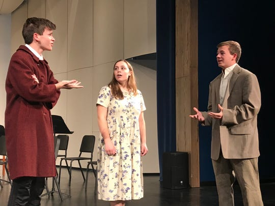 Teacher Leon Tolchinsky (Josh Cole) talks with Dr. Nikolai Zubritsky (Nick Walker) and Lenya Zubritsky (Gabby Gjerding).