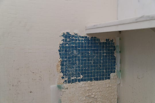 Blue tiles are found as the walls of a bathroom in the  historic Wave House are stripped down, Palm Desert, Calif., Tuesday, October 30, 2018.