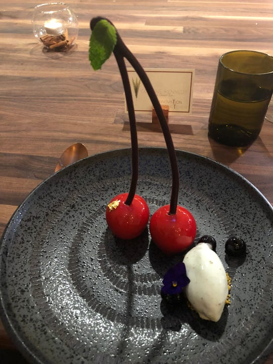 Black cherry mousse with pistachio ice cream at T&T Innovation Kitchen.