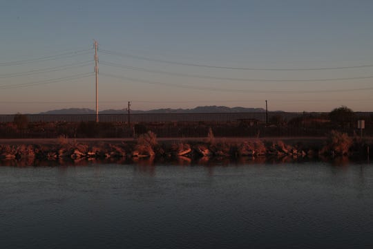 The All-American Canal runs along the U.S.-Mexico border on April 11, 2018, delivering water to the Imperial Valley.