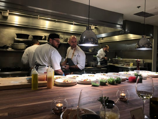 Executive chef Peter Smith, right, helps with preparation at the T&T Innovation Kitchen.