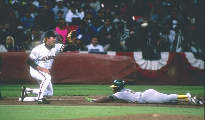 Oct 1989:  Outfielder Rickey Henderson of the Oakland Athletics slides into third base as infielder Greg Litton of the San Francisco Giants tries to tag him out during the World Series at Candlestick Park in San Francisco, California.