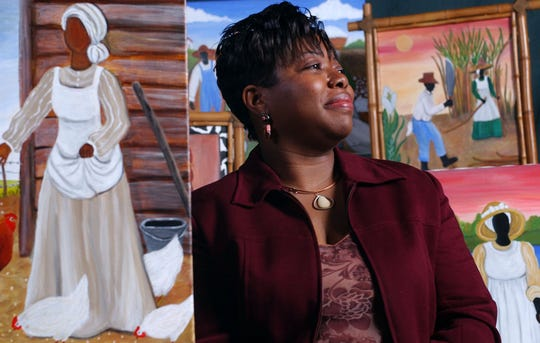 Artist Sonja Griffin Evans stands surrounded by some of her work that celebrates Gullah history in this file photo.