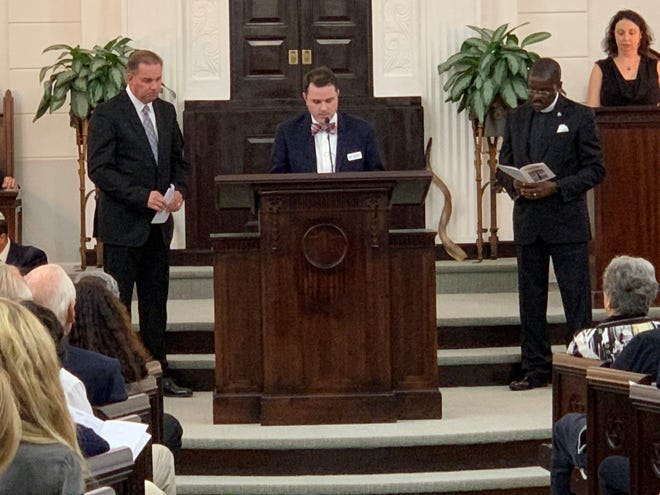 From left, Pastor Joey Rogers from the Pace Assembly of God; Rev. Brandon Bures, associate pastor of First United Methodist Church; and Rev. Freddie Tellis of Allen Chapel AME take turns reading prayers during a service at Temple Beth El on Oct. 30 honoring the victims of the Pittsburgh synagogue shooting.