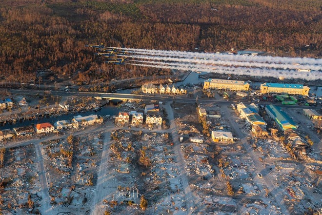 U.S. Navy Blue Angels fly over hurricane-devastated Mexico Beach on Sunday, Oct. 28, 2018.