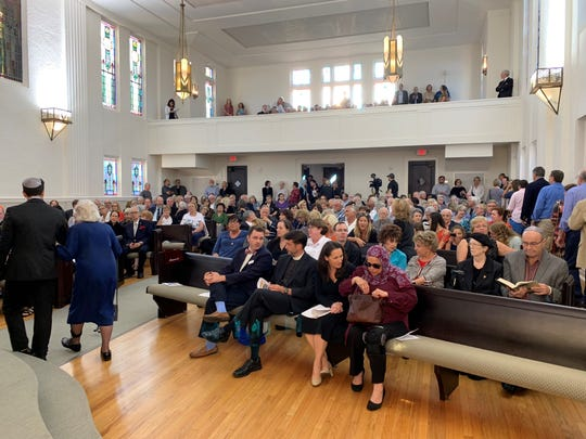 People gathered in the sanctuary at Temple Beth El in Pensacola for a service honoring the victims of the Pittsburgh synagogue shooting.