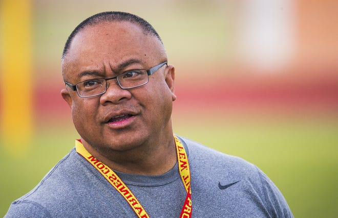 Mesa High School head football coach Kapi Sikahema speaks to an assistant at team practice, Tuesday, September 26 2017.
