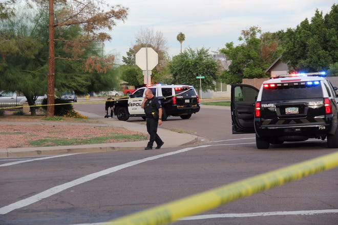 A police officer is seen Monday afternoon near the site of a  shooting near Baseline Road and Mill Avenue that involved Tempe police.