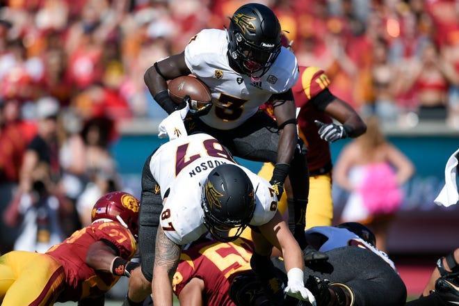 Arizona State Sun Devils running back Eno Benjamin (3) runs the ball during the first half against the Southern California Trojans at Los Angeles Memorial Coliseum.