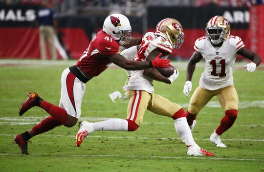 Cardinals safety Antoine Bethea tackles 49ers receiver Kendrick Bourne during the second half of a game Oct. 28 at State Farm Stadium.