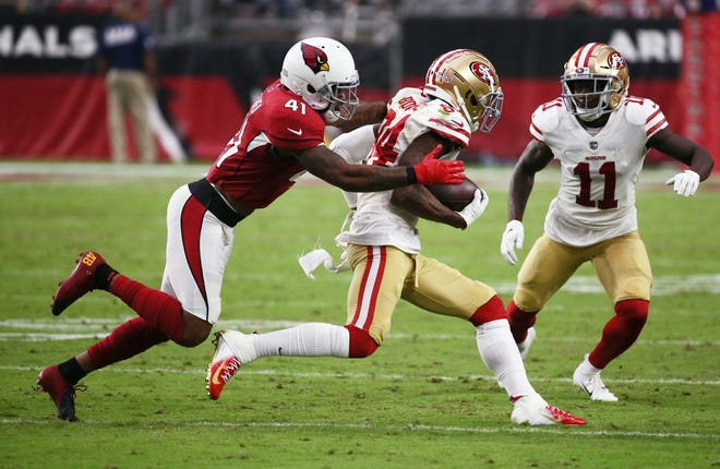 Arizona Cardinals safety Antoine Bethea tackles San Francisco 49ers' Kendrick Bourne in the second half during a game on Oct. 28 at State Farm Stadium.