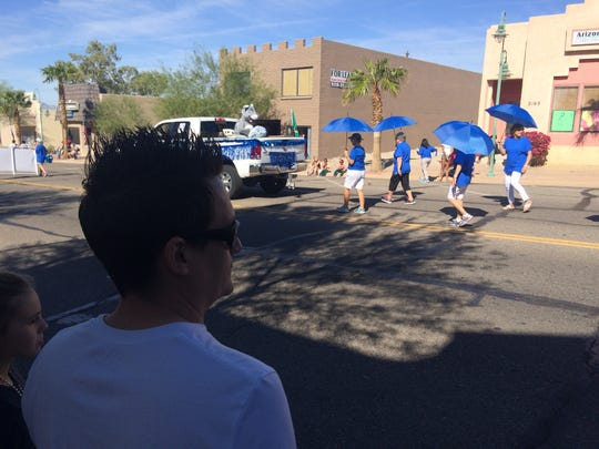 Mike Bell, a Republican from Lake Havasu City, watches stone-faced as the Mohave County Democrats walk by during the London Bridge parade on Oct. 27, 2018.