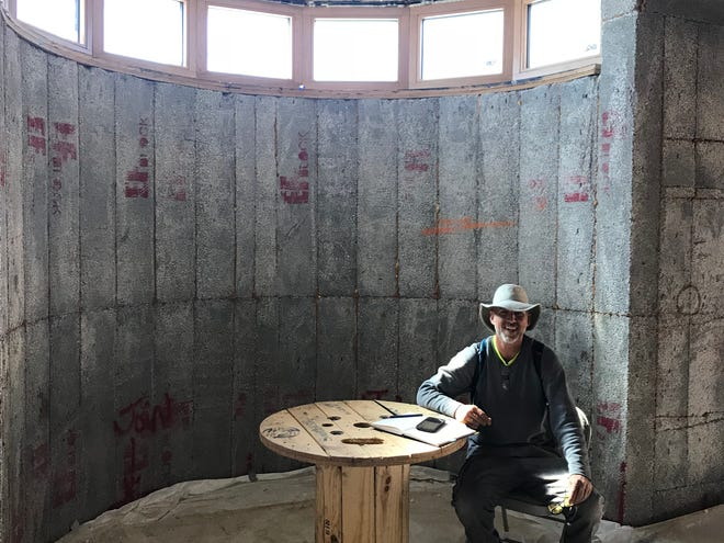 """""""One  of  the  things  that  keeps  me  going  is  it  really  has  the  feel  that  I  wanted  it  to  have,"""" says  Carpenter,  pictured  here  sitting  in  what  will  be  the  breakfast  nook. """"When  I  walk  into  a  room  I  think this  is  what  I  hoped  it  would  feel  like, and  I  know I'm  on  the  right  track."""""""