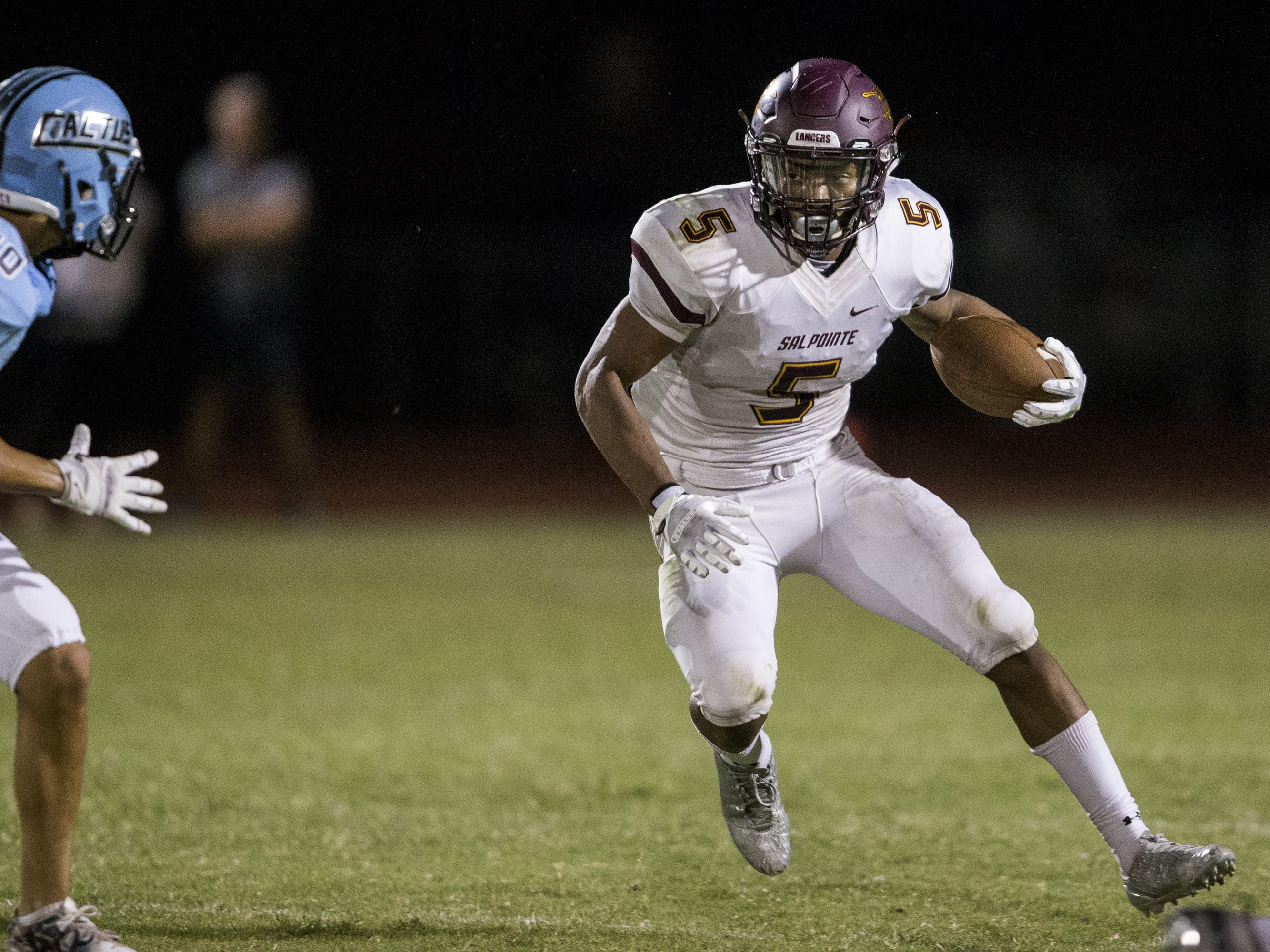 Salpointe's Bijan Robinson rushes against Cactus in the 1st quarter on Friday, Sept. 14, 2018, at Cactus High School in Glendale, Ariz.
