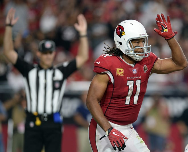 Arizona Cardinals wide receiver Larry Fitzgerald (11) celebrates a touchdown against the San Francisco 49ers during the second half at State Farm Stadium.