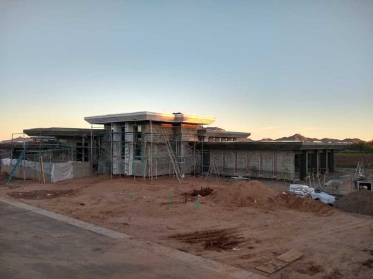 Ten  months  into  construction,  the  Carpenter  home  in  Chandler  is  taking  shape.  The  windows  have  been  installed.  Electrical,  mechanical  and  plumbing  are  going  in  right  now.
